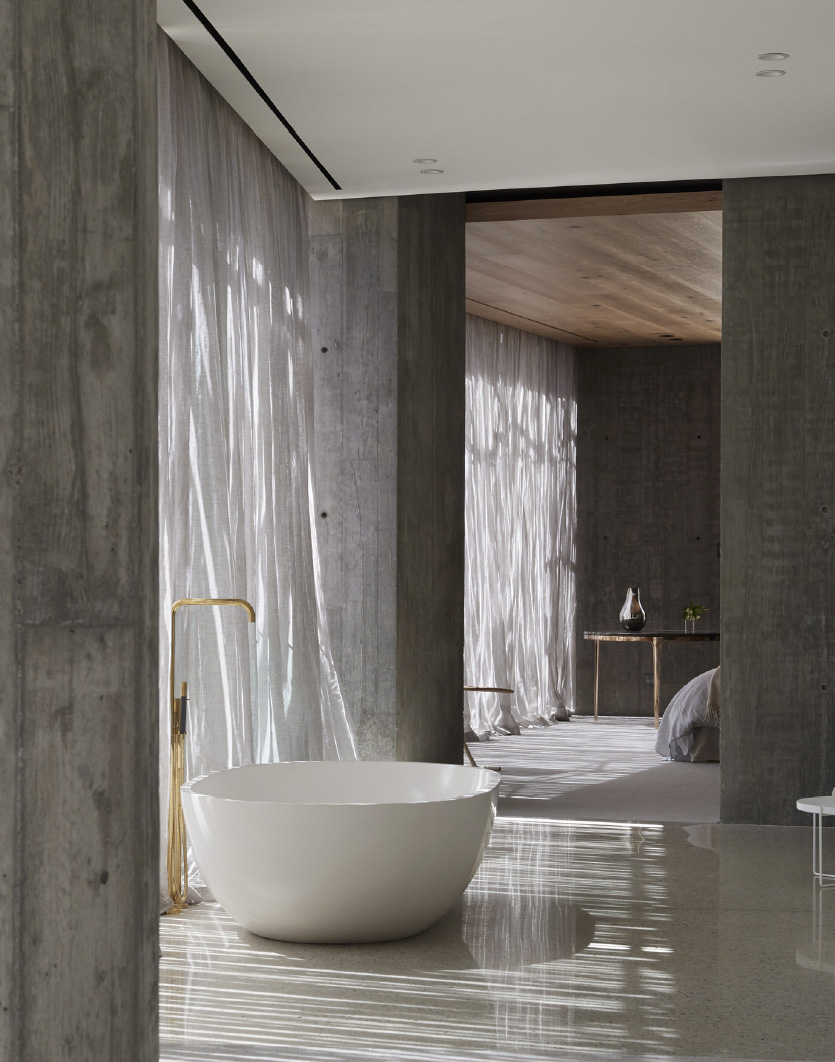 large luxury freestanding bath in a spacious room with dappled light